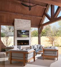 outdoor fireplace and patio contemporary with tv above modern flush