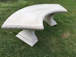 large curved stone garden seat bench