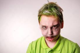 ager boy with a zombie makeup on stock photo