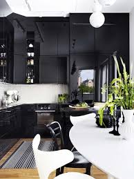 kitchen contemporary black white dining table set striped rug on wooden floor chandelier kitchen design