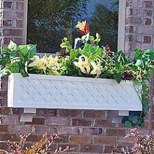 Decorative Window Boxes Side view of decorative window box with pink flowers close up 51