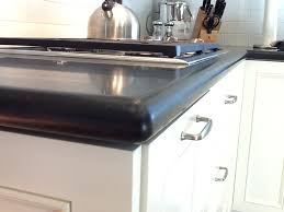 simple kitchen with honed granite kitchen countertop black black color stainless steel paper towel holder