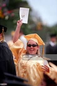 Marisa Gaines waves to family during graduation at Ventura High ...