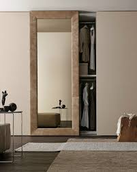 sectional mirrored wardrobe with sliding doors mirror by presotto industrie mobili design pierangelo sciuto