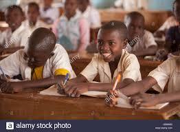 children smiling at school desks