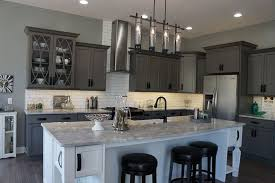 gray cabinets with river white granite