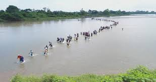 Image result for illegals stroll across Rio Grande with luggage