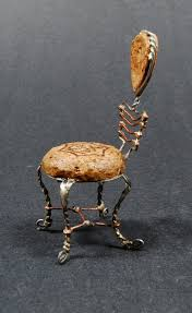 a little miniture chair made from a champagne cork and wire love