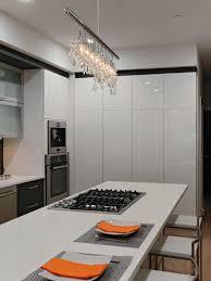 modern white kitchen with crystal chandelier