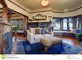incredible royal blue living room authentic styled living room with royal blue rug stock photo