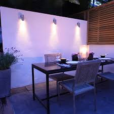 exterior wall lighting ideas. Breathtaking Outdoor Wall Mounted Lighting Motion Sensor Switch White And Lamp Lighten Wooden Table Chairs Vase With Plant Exterior Ideas