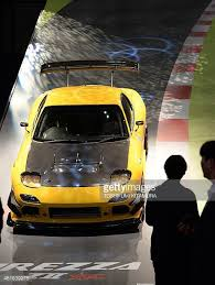mazda rx7 2014. mazda rx7 car is on display at the dunlop booth during tokyo auto salon 2014 rx7 e