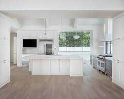 white modern kitchen with gray wash wood floors