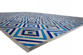 floor view of a grey and blue diamond patchwork cowhide rug