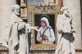 donald trump and hillary clinton react to mother teresa s  a tapestry of st teresa of kolkata is seen on the facade of st