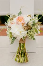 las wedding bouquets and a gentleman s boutonnieres