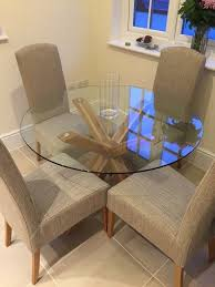 next oak and glass round dining table with 4 x sienna chairs