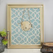 diy summer sand dollar art made from a picture frame fabric and string