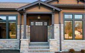 wood doors with iron outdoor pendant lights entry craftsman and square columns