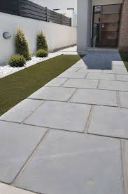 laying outdoor tiles over concrete