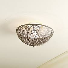 The Celine Clip-On Ceiling Shade is a simple, yet elegant, solution to  covering up an exposed ceiling bulb.