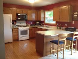 Barstools And Laminate Countertops With Oak Kitchen Cabinets Also Window  Treatment And Unfinished Pine Cabinets With