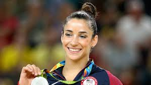 silver medalist aly raisman celebrates on the podium at the medal ceremony for the women s floor