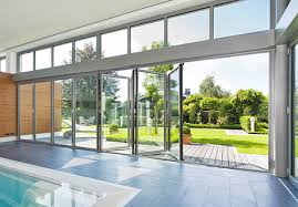 sl80 and sl81 are energy efficient folding glass wall systems with aluminum panel stiles and rails available as narrow as 1⅞ inches to maximize views