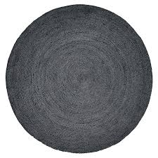 nordal black round jute rug outdoors loading zoom