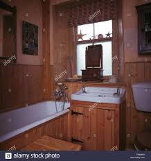 washstand bathroom pine: blind on frosted window above basin in pine vanity unit in pine