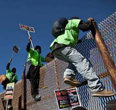 why has illegal immigration from declined on point deported migrants climb a fence at the u s border as they prepare for the