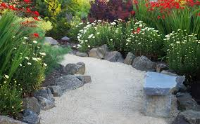 this next garden edging idea is perfect for a large garden that has an incorporated path using rocks of this size to create a border gives the design an