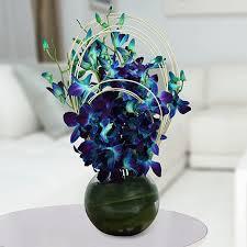 purple orchids vase arrangement send gifts to hyderabad