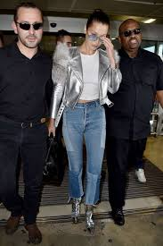 jacket silver metallic biker jacket ankle boots metallic shoes bella hadid cannes top jeans spring outfits
