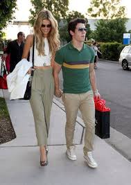 She has won 23 aria awards and a logie. Nick Jonas And Delta Goodrem Photos Nick Jonas Visits His Girlfriend Casual Chic Style Style Outfits