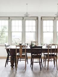 wood farmhouse table with orted wood chairs in dining room of tamsin carvin s farmhouse in victoria australia design files eve wilson photography