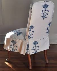 slipcover i like the shape and details on the chair although the print is dining room