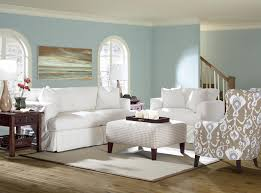 white oversized chair slipcover with area rug and