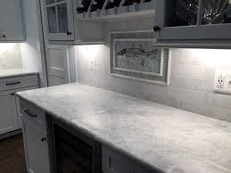atlas tile while marble countertop while horizontal brick backsplash and fish mosaic