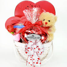 cute chocolate idea for valentines day gift in a white basket along with teddy bear