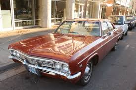 OLD PARKED CARS.: 1966 Chevrolet Bel Air.