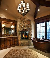 master bath with copper soaking tub and fireplace paula berg design