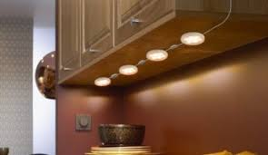 Under kitchen cabinet lighting Low Voltage Under Cabinet Puck Lights 345x200 How To Choose Under Cabinet Lights For Any Kitchen Thecoolist How To Choose Under Cabinet Lights For Any Kitchen