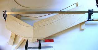 to make the legs start by making a template for the legs shape the leg itself is 65 cm high and 8 5 cm wide along its curved part except where the legs