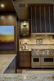 glass and stone backsplash in kitchen contemporary with curved range hood accent lighting backsplash lighting