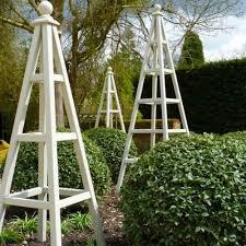 wooden garden obelisks a little bird