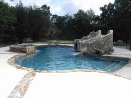 Pool- Gunite pool with a custom waterfall, slide, and grotto combo with  Flagstone