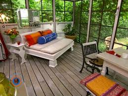 glass screened in porch with daybed and wood floors