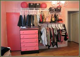 closet systems home depot wire hanging rods and pink drawers closet system home depot under chandelier