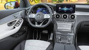 It's swathed in trim that flows down from the center display screen, in a wood or metallic waterfall. 2020 Mercedes Glc Coupe Interior Youtube